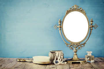 Old vintage oval mirror and wo