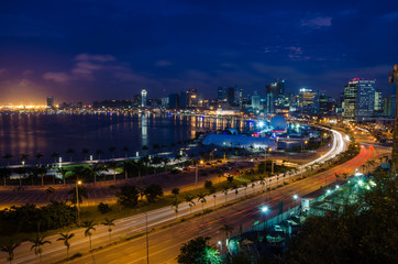 Skyline of large African city Luanda and its seaside during the blue hour with many lights