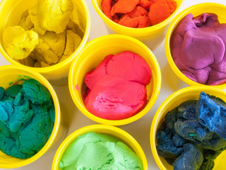 colorful play dough in yellow can