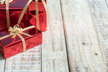 Gift box on the wooden table.