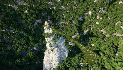 Old fantsay castle on a high cliff, rock. Aerial view. fabulous landscape
