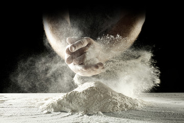 desk of flour and hands