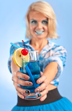"""Young beautiful woman with cocktail """"Blue lagoon"""""""