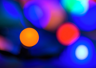 Abstract vibrant bright round bokeh over dark background