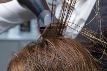 Hair Care. Women drying hair
