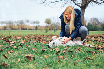 Happy dog with woman outdoors