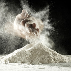 men and hands and flour