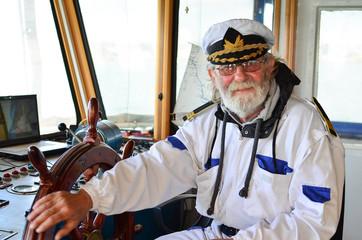 Smiling, satisfied captain, bon voyage