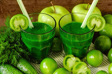 green smoothies with fresh vegetables and fruits