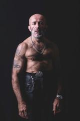 Bald and tattooed man