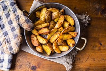 Potato. Roasted potatoes. American potatoes with salt pepper and cumin. Roasted potato wedges delicious crispy.