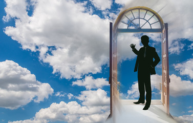 Beautiful sky background with a man in a doorway making the invitation gesture towards the sky