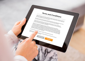 Person accepting terms and conditions on tablet
