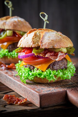 Two tasty hamburger made of lettuce, beef and cheese