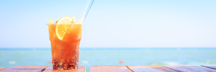 Concept of luxury tropical vacation. One Cuba Libre cocktail on