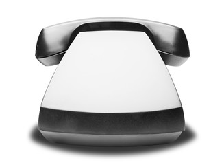 Old vintage black telephone with shadow on white background