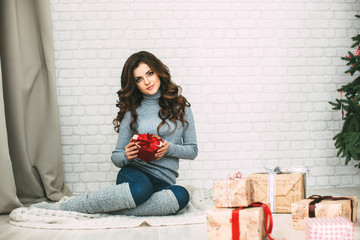Happy woman with gift.