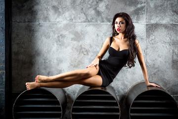 Fototapete - Portrait Of Sexy Woman On a dark metallic Background