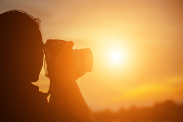 Women Nature photographer with digital camera on the mountain