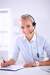 Close-up portrait of a customer service agent sitting at office