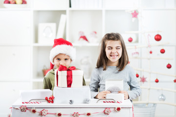Two little kids are exited about their Christmas presents
