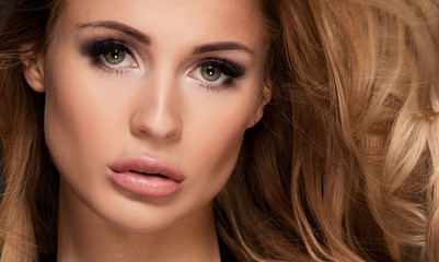 Beautiful girl with glamour makeup.