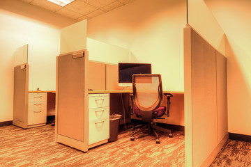 Office cubicle sits empty in an office building
