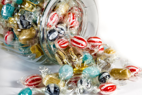 Wrapped Sweets Spilling from a Jar