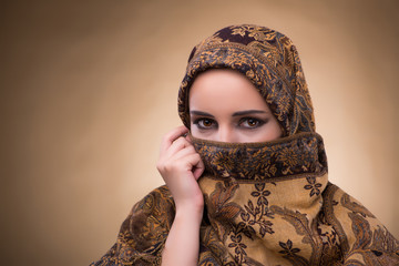 Young woman in traditional muslim clothing