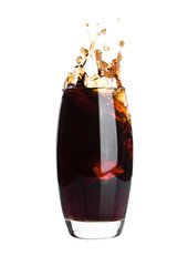 Glass of cola with splash and ice cubes on white
