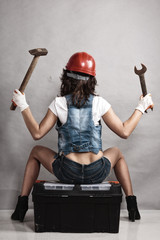 Sexy girl mechanic working with tools. Back.