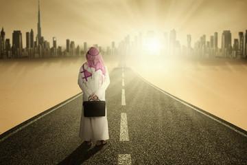 Arabic entrepreneur standing on road