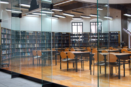 modern library: empty reading room with tables