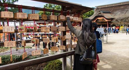 Wooden prayer tablets in Dazaifu shrine Fukuoka Japan