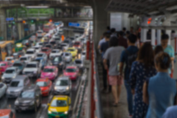 Blurred background skywalk and heavy traffic at Bts Siam Square.