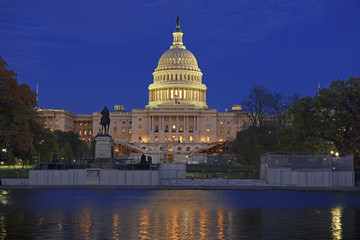 The Capitol Building in Washington DC at night with reflection in pond, capital of the United States of America