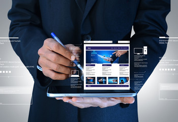 business man showing web page on tablet