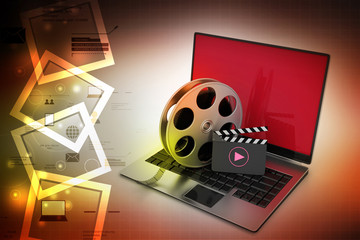Laptop with reel wheel and clap board in color background