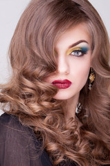 Gorgeous girl with make up and hairstyle