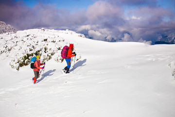 Climbers are on snow slope.