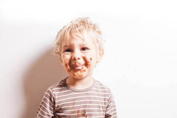Boy eated chocolate