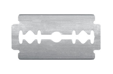 Old razor blade isolated on white background