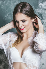 Young beautiful woman in a fashionable linen luxury brunette