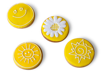 Top view of iced biscuits. Yellow cookies with decoration. Smiley face and sun. Art starts with simplest things.