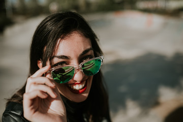 Woman looking above sunglasses