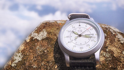Word of No time to lose on wristwatch on sky background, time management concept