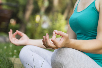 Young beautiful woman meditating. yoga practice. breathing exercises.