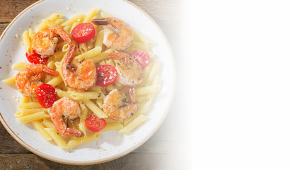 Penne pasta with shrimps and tomatoes.
