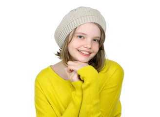 Portrait of a cute teen girl in a yellow sweater and a knitted c