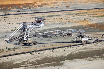 Giant excavator working on opet pit coal mine